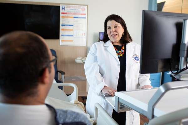 Dr. Rhonda Cooper-DeHoff with patient