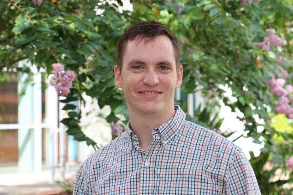 Dr. Cameron Thomas headshot